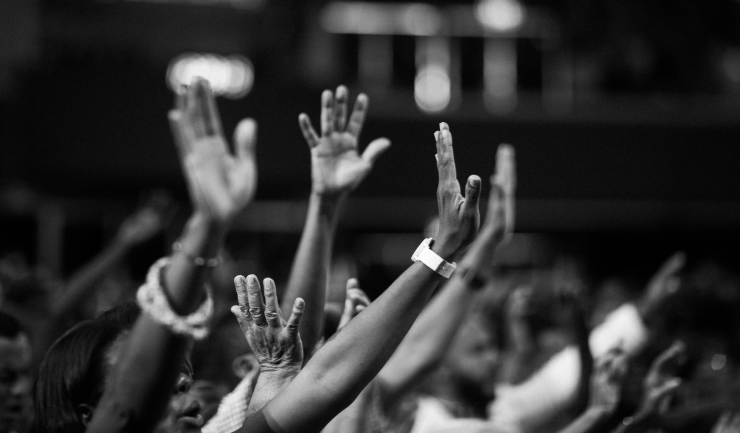 hands raised B:W cropped